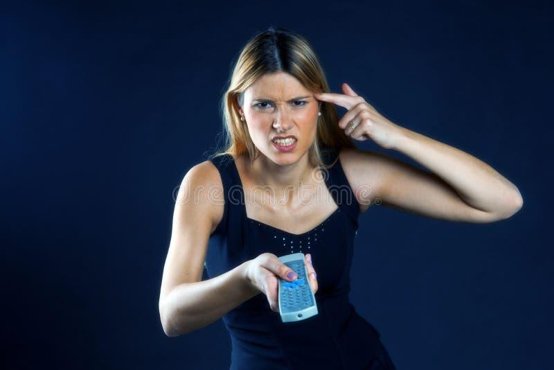 контролируйте дистанционную женщину стоковая фотография