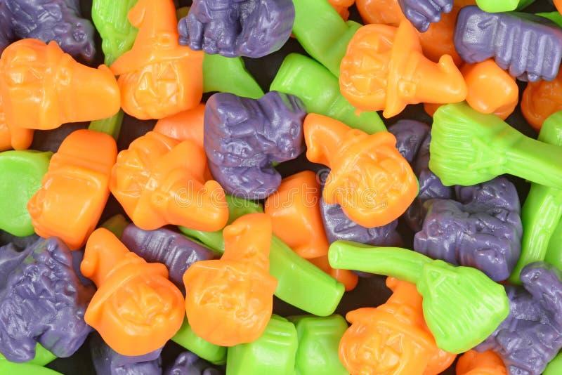 Конфета котов веников ведьм хеллоуина макроса стоковое изображение