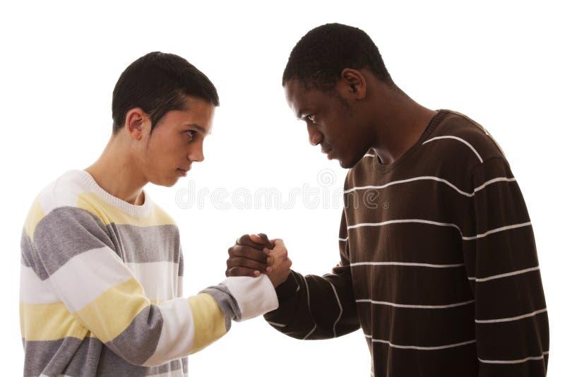 конфронтация multiracial стоковые изображения rf
