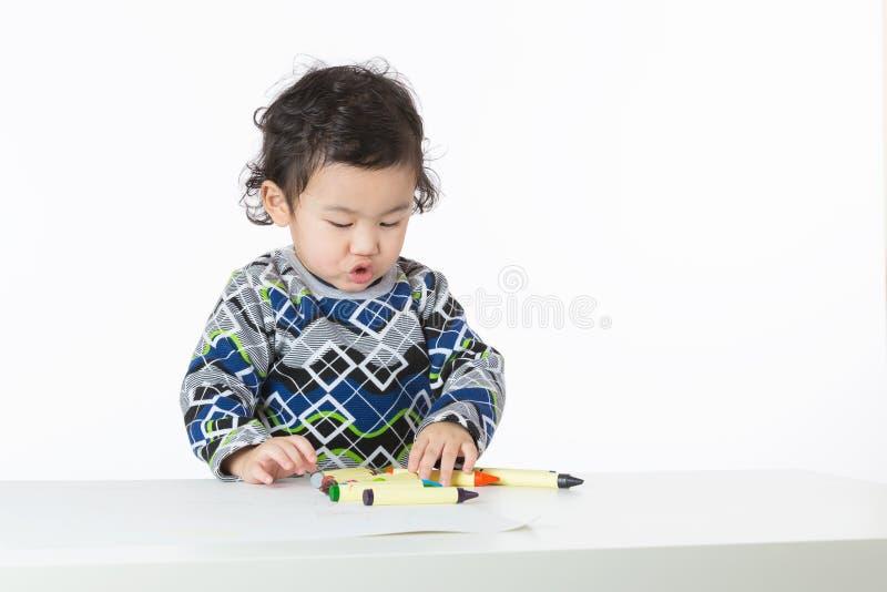 Концентрат ребёнка Азии на чертеже стоковые фотографии rf