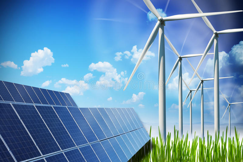 Концепция возобновляющей энергии с панелями солнечных батарей и ветротурбинами на зеленом поле стоковое изображение rf