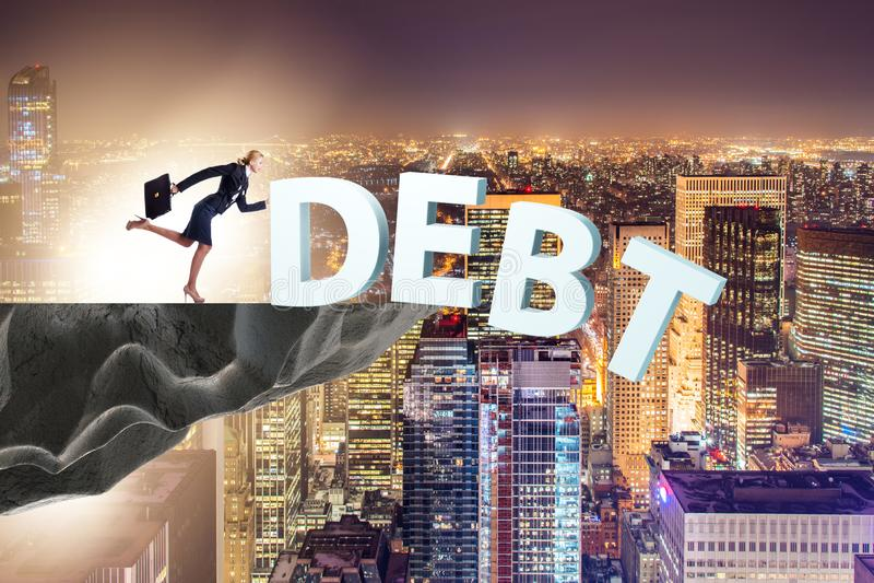 Концепция долга и кредита с бизнесменом стоковое фото