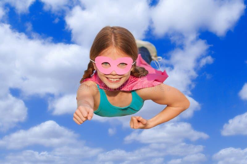 Концепция летания перемещения супергероя стоковое изображение rf