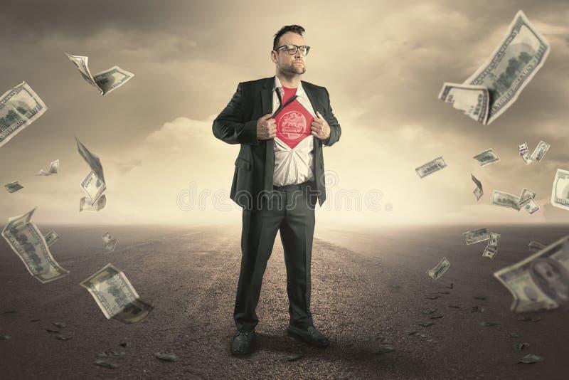 Концепция земли бизнесмена супергероя стоковая фотография rf