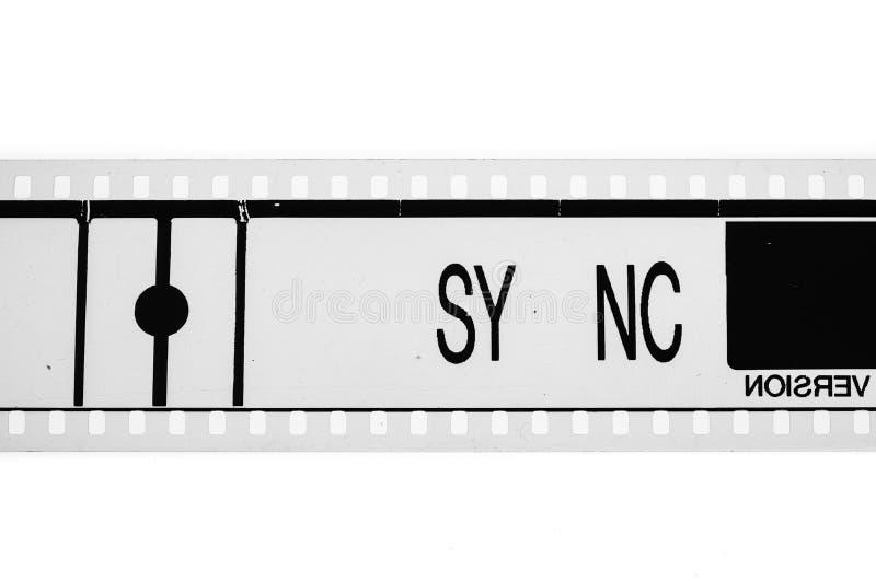 Концепция знака синхронизации на черно-белом вьюрке фильма фильма стоковые изображения rf
