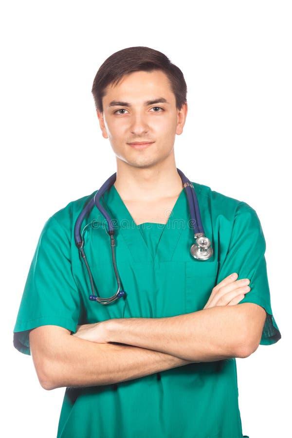 Концепция здравоохранения, профессии, людей и медицины - усмехаясь мужской доктор в белом пальто стоковые изображения rf