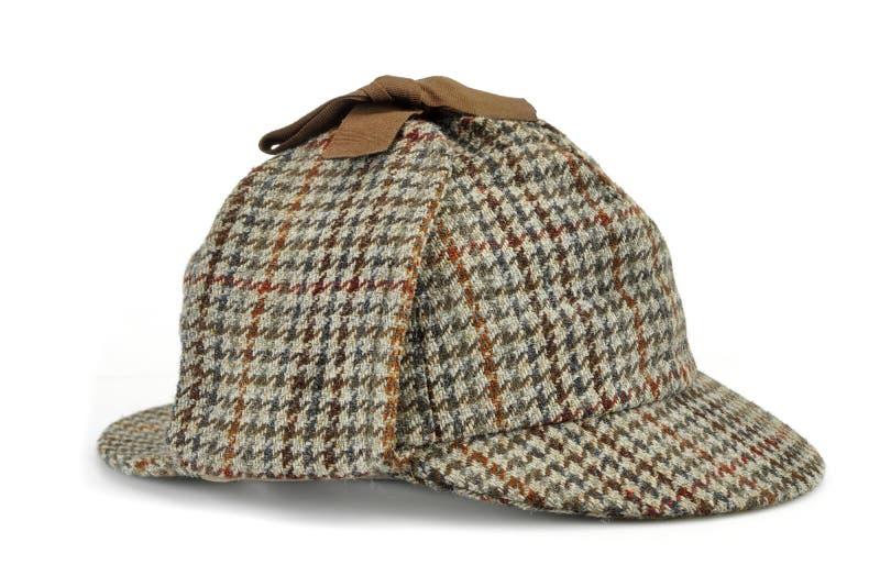 Концепция исследования с шляпой Sherlock Holmes известной как олени стоковая фотография