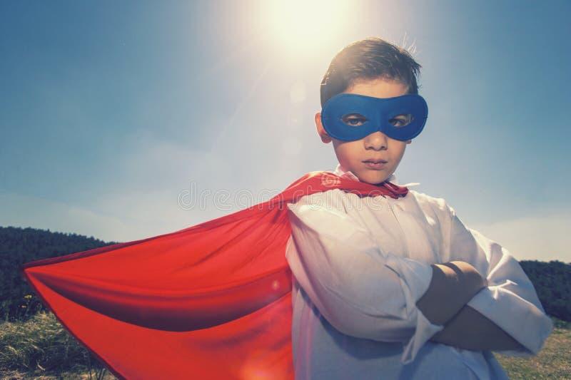 Концепция мальчика супергероя стоковое фото rf