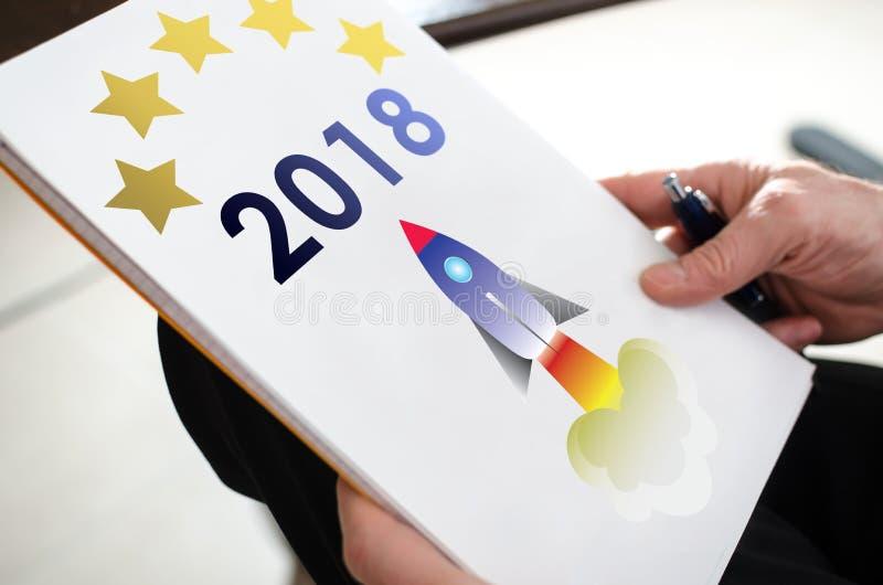 Концепция 2018 Нового Года на бумаге стоковое изображение