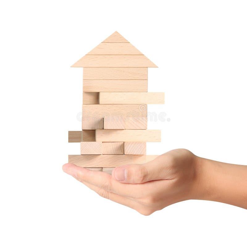 Концепция домом от в руки стоковое изображение