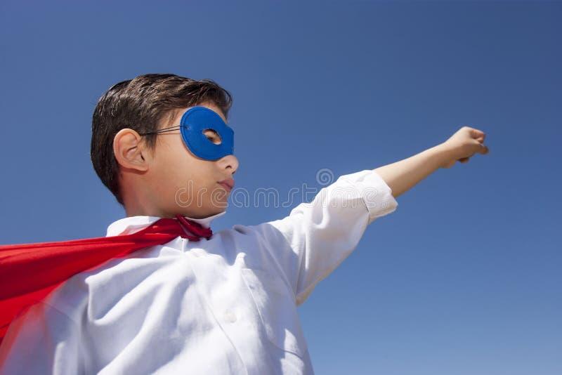 Концепция ребенк супергероя стоковое изображение rf