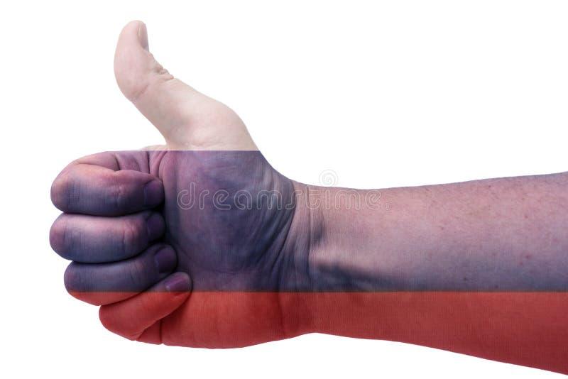 Концепция Росси-руки поднимает большой палец руки вверх с флагом России стоковая фотография