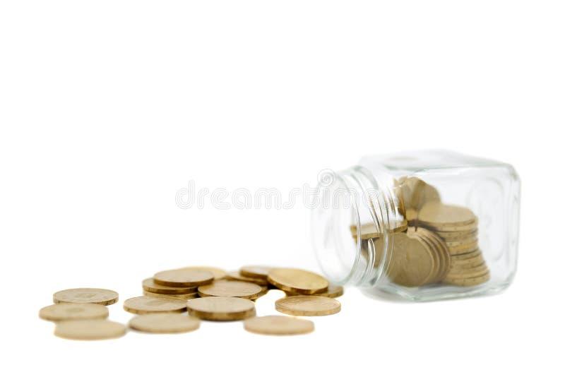 Концепция сбережений с монетками в опарнике стоковые изображения rf