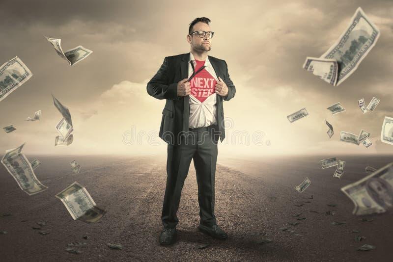 Концепция следующих шагов бизнесмена супергероя стоковое изображение