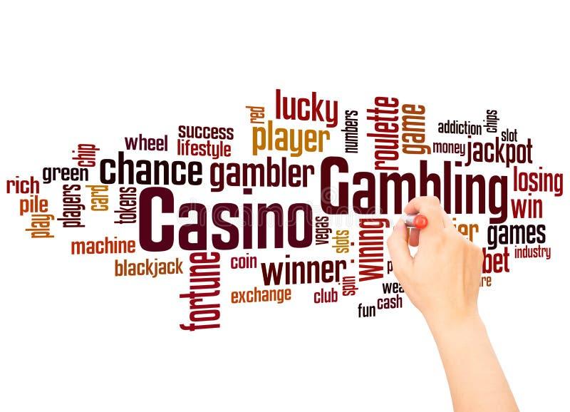 Концепция сочинительства облака и руки слова казино играя в азартные игры стоковые фото