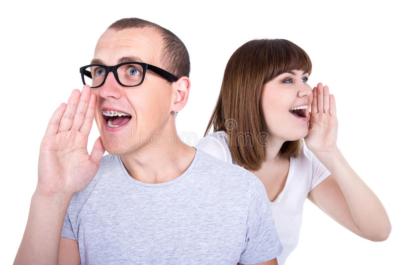 Концепция сплетни или продажи - профиль смешных молодых пар вызывая s стоковые изображения rf