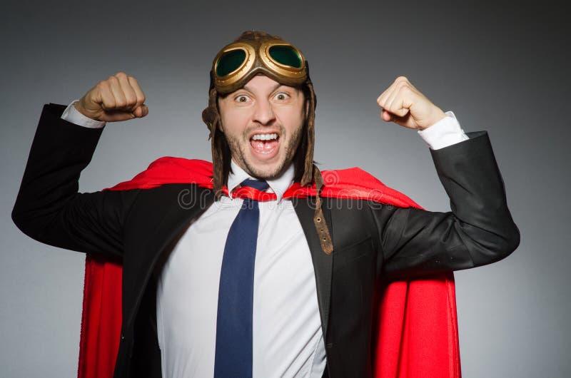 Концепция супермена с человеком стоковые изображения rf