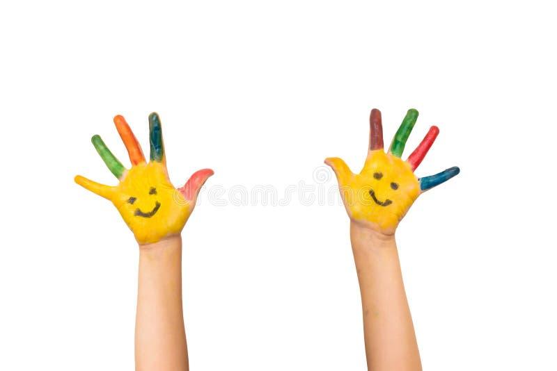 Концепция улыбки, счастья и потехи Счастливыми руки ребенк покрашенные выставками стоковое изображение rf