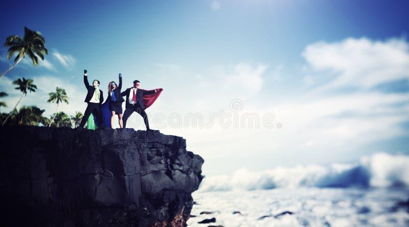 Концепция успеха достижения скалы края супергероев дела стоковая фотография