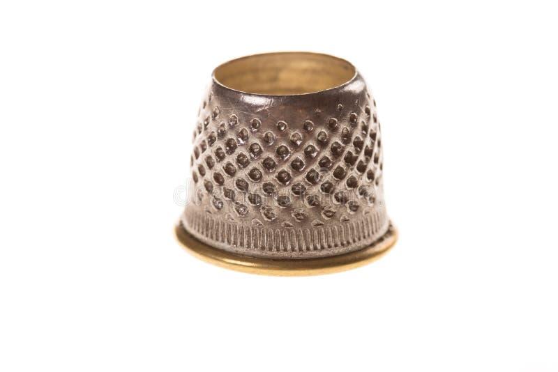 Кончик пальца металла на белизне стоковые изображения