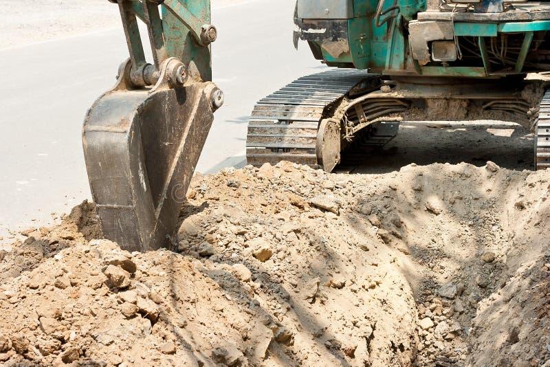 Копать экскаватором трактора стоковое фото rf