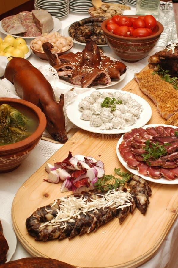 Копченая свинья, ветчина, сосиска и другие еды стоковое фото