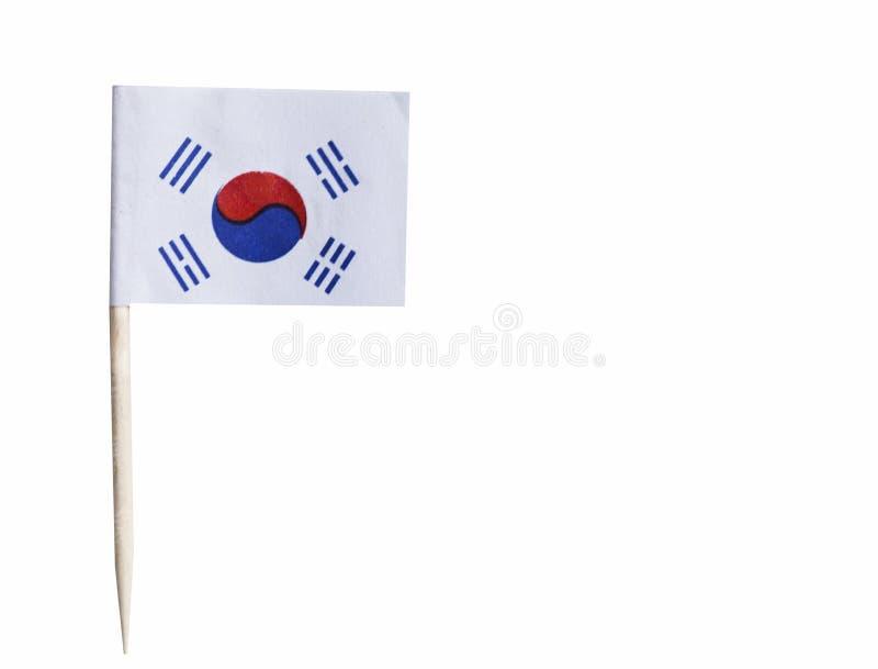 Корейский флаг в зубочистке против белой предпосылки стоковое фото