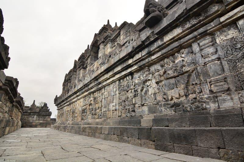 Коридор со сбросами на стене Висок Borobudur Magelang Центральная Ява Индонезия стоковые изображения