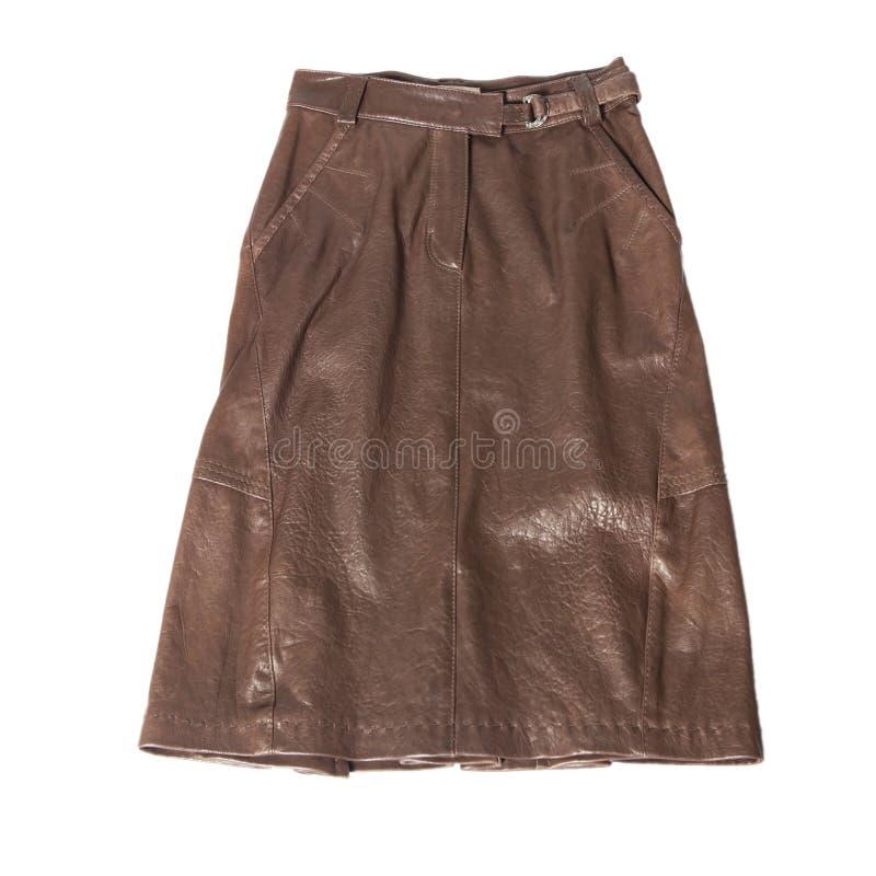 коричневая кожаная юбка изолированная на белизне стоковое фото rf