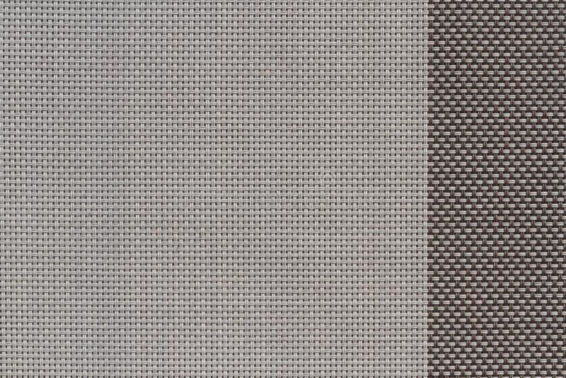 коричневой сплетенные пластмассой образцы ткани, предпосылка текстуры стоковое изображение