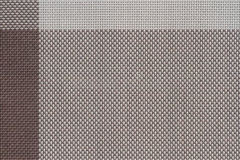 коричневой сплетенные пластмассой образцы ткани, предпосылка текстуры стоковое изображение rf