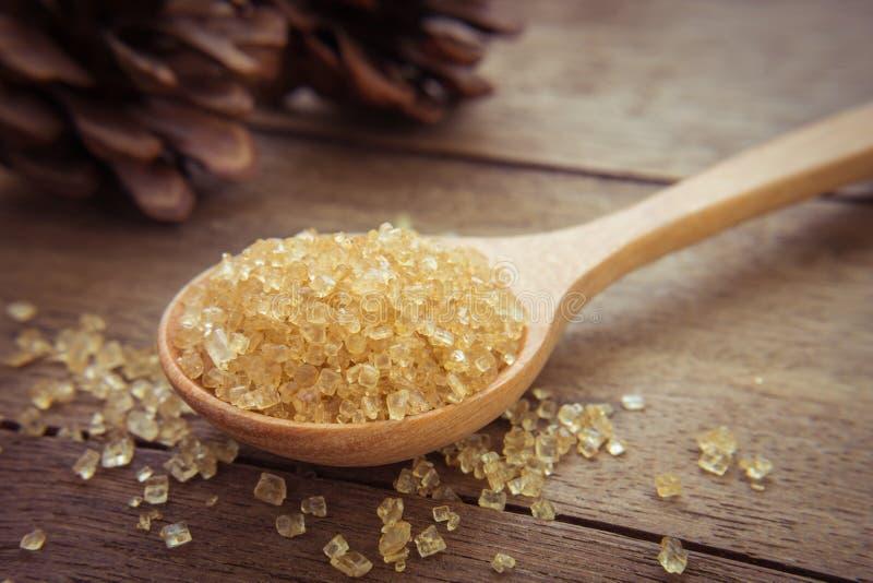 коричневый сахар ложки деревянный стоковая фотография rf