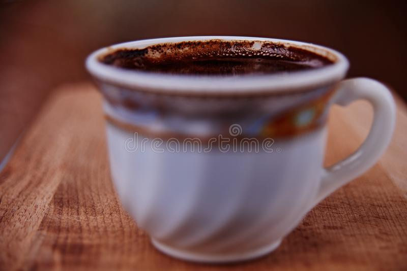 Коричневый цвет кафа чашки питья Coffe стоковое изображение