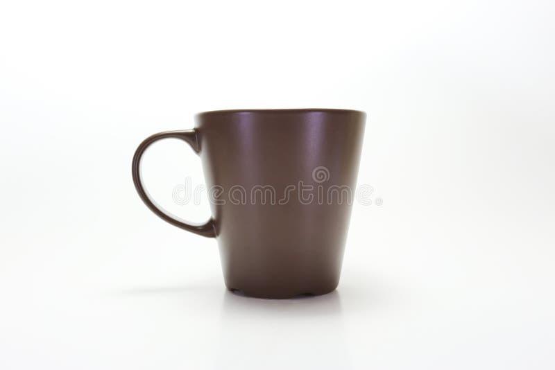 Коричневый цвет стекла чашки стоковая фотография rf