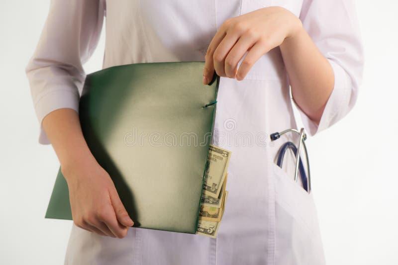 Коррупция в медицине стоковое фото