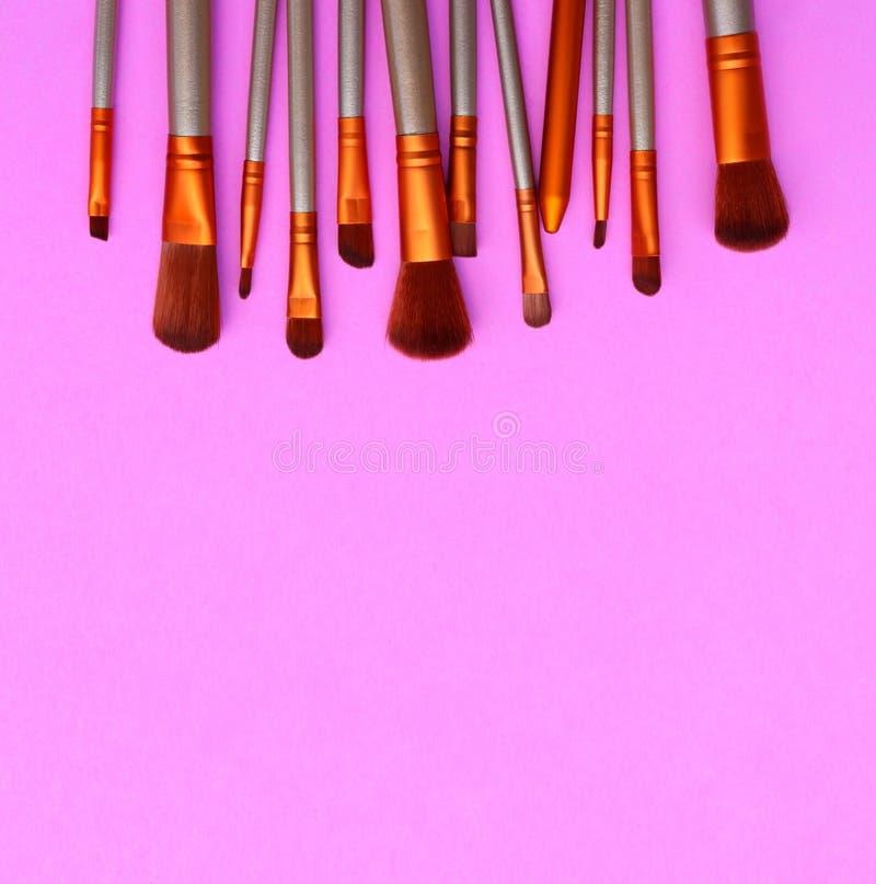 Косметика на розовой предпосылке стоковые фото