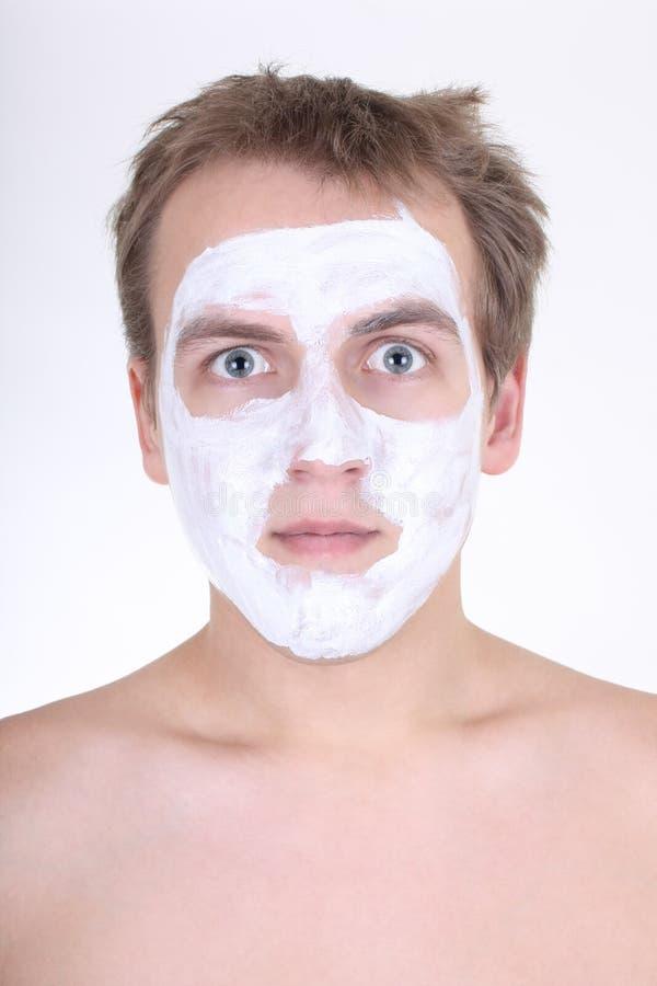 косметическая сторона его детеныши маски человека стоковая фотография