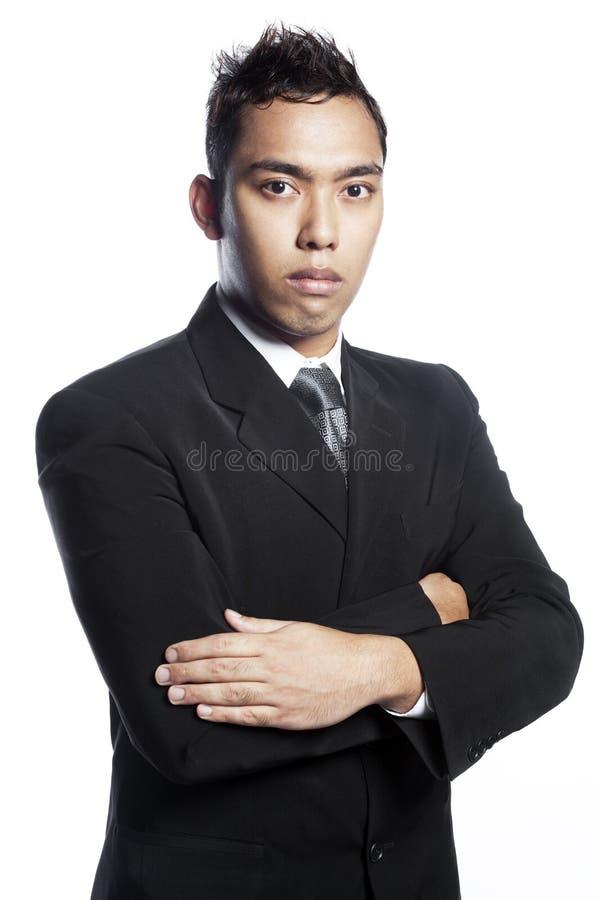 костюм азиатского дела хвастуна свирепый смотря стоковые фото