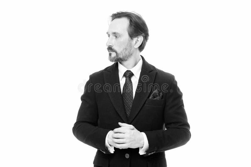 Костюм вдохновляет чувство доверия джентльмена Фотомодель человека красивая уверенная зрелая нести модный костюм на белизне стоковое изображение