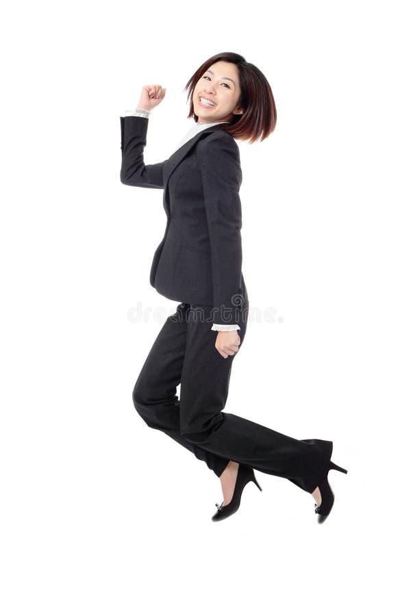 костюм коммерсантки радостный скача успешный стоковое фото rf