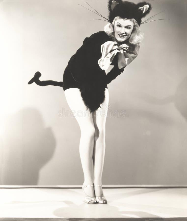 Костюм кота женщины нося стоковое фото rf