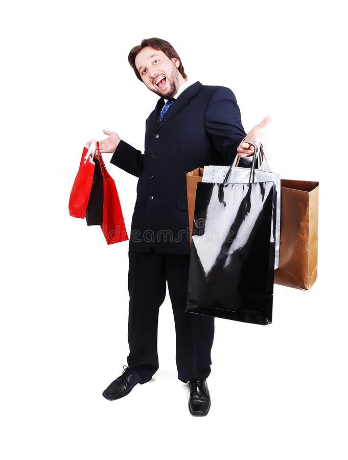 Костюм молодого привлекательного человека нося и магазин держать стоковые фотографии rf
