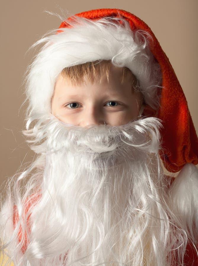 костюм claus маленький santa мальчика бороды стоковое изображение