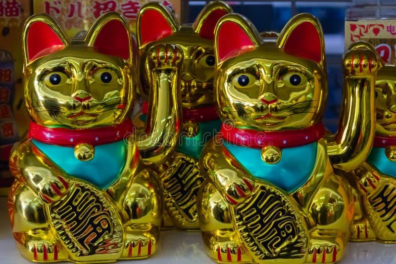 Коты Maneki Neko Японии удачливые стоковые изображения