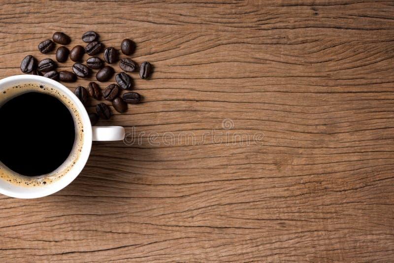 Кофейная чашка с кофейным зерном стоковые изображения rf