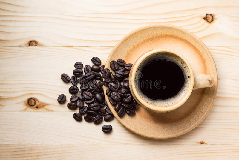 Кофейная чашка с кофейным зерном стоковая фотография rf