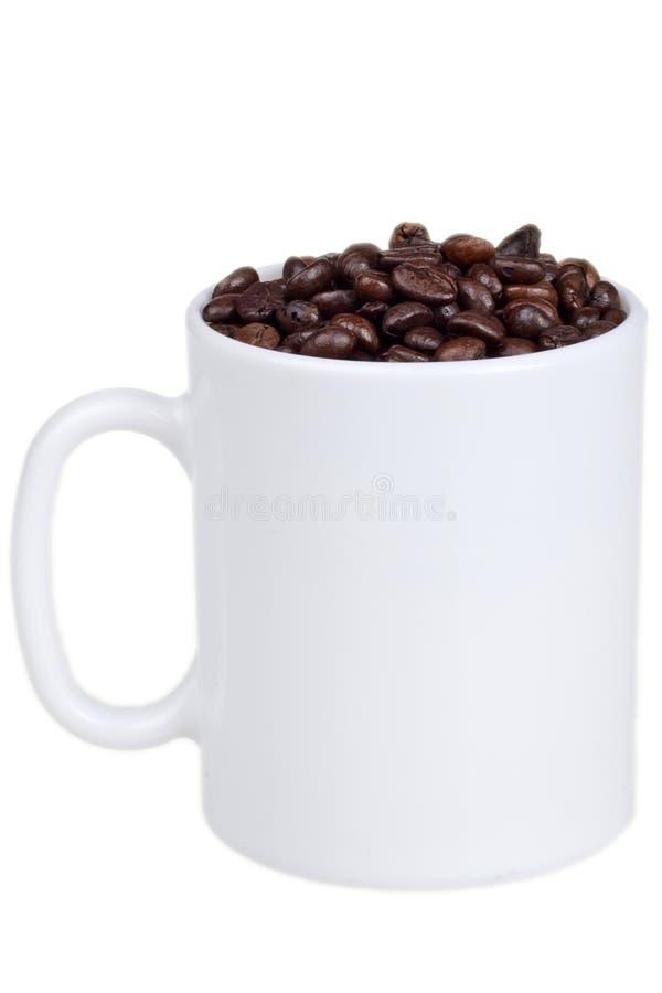 Download Кофейные зерна и чашка стоковое изображение. изображение насчитывающей кофе - 41661881
