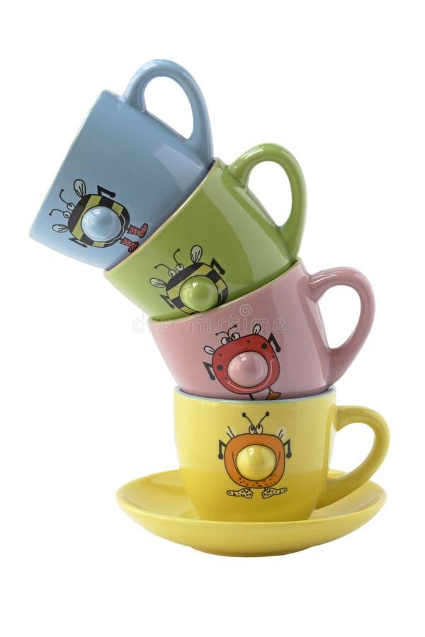 Кофейные чашки цветастые и смешные стоковая фотография