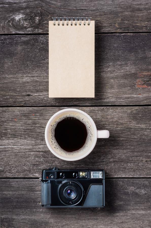 Кофе и камера блокнота стоковое изображение