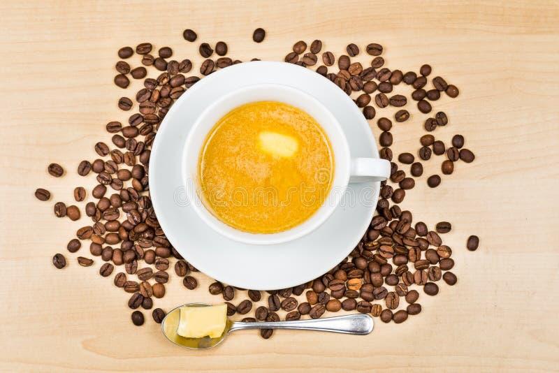 Кофе с молоком и добавленным маслом стоковое фото rf